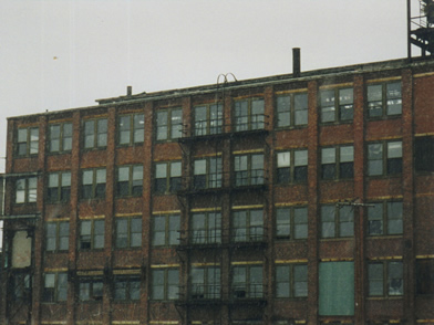 <strong>Custom Shop Building</strong>(Left side, 2nd window from top was the engraving room)