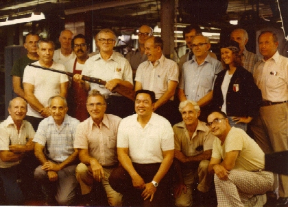 Back Row: Ted Tomaseck, John Durkin, Joe Tomaseck, Herb Rothman, Bruno Pardee, Pete Sgro Middle Row: Walt Stopka, Gerry Boetger, Spiro Pappas, Joe Crowley, Pauline Muerrle, Bud Colburn  Front Row: Russ Titus, George Demato, Nick Kusmit, Grant Tom (customer), Nick Colomonico, George Crane